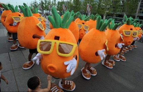 Pang Kun and his 48 friends in their carrot costumes before he proposes to his girlfriend