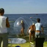 Initially it appears as though she has got the hang of things, managing the few steps off the beach and into the water in the giant ball.