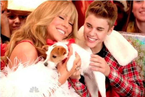 "Mariah Carey with Justin Bieber in the video for their version of hit song ""All I Want For Christmas Is You"""