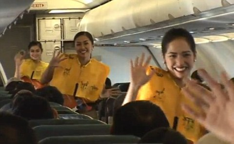 The Cebu Pacific air hostesses gyrate their way around the cabin while giving the safety demonstration