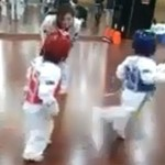 The toddler in blue attempting a hilarious back kick