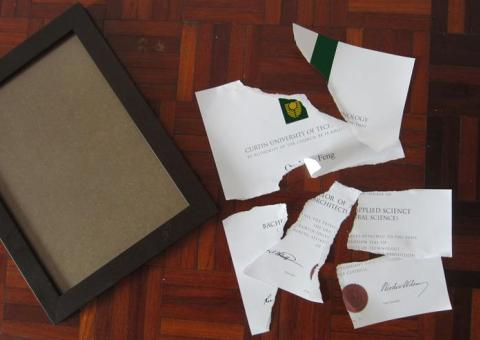 A Curtin graduate apparently tore up her Curtin certificate in protest