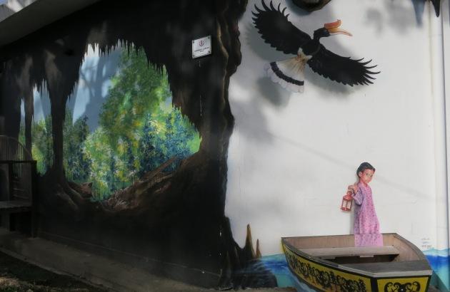 Gua Niah , hornbill and Malay girl in sampan