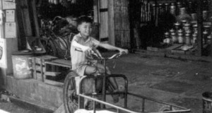 "That is me as a kid sitting on my dad's three-wheel ""Harley-Davidson"" in Binatang"