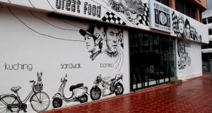 The murals on the outside walls of the cafe