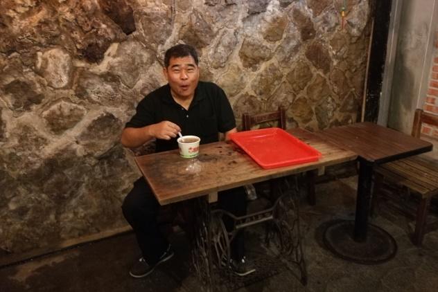 Ah Mang Ker enjoying his taro balls