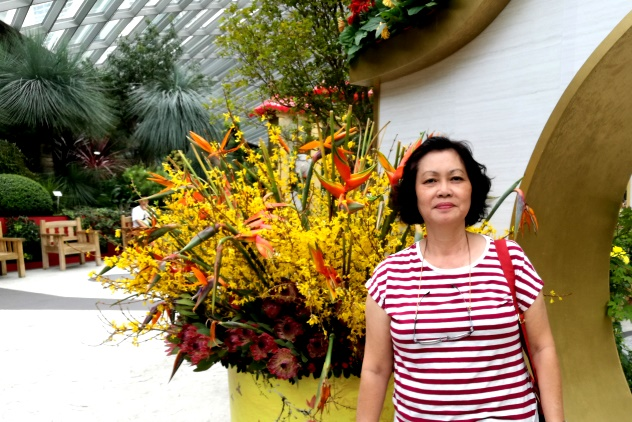 My wife posing near paradise flowers