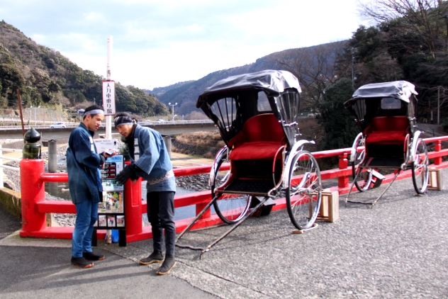 Two Japanese rickshaw pullers