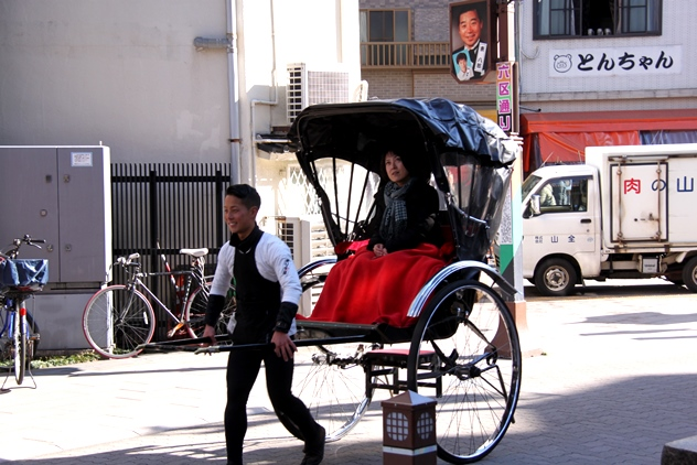 A Japanese rickshaw puller and his female customer