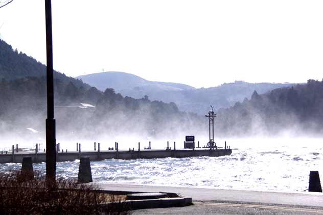 A mist of water whipped by the strong winds