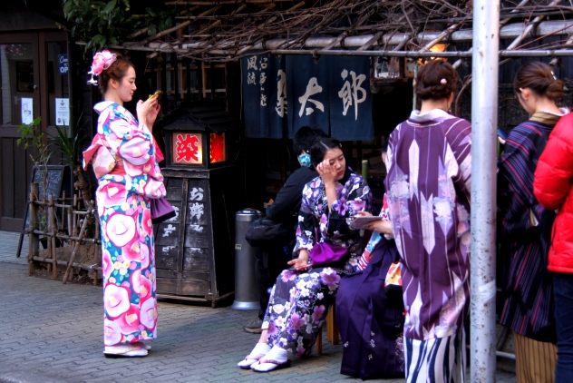 Some Japanese women awaiting their turns to enter the restaurant