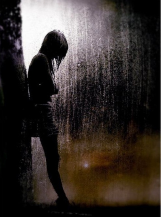 Lonely girl in the rain